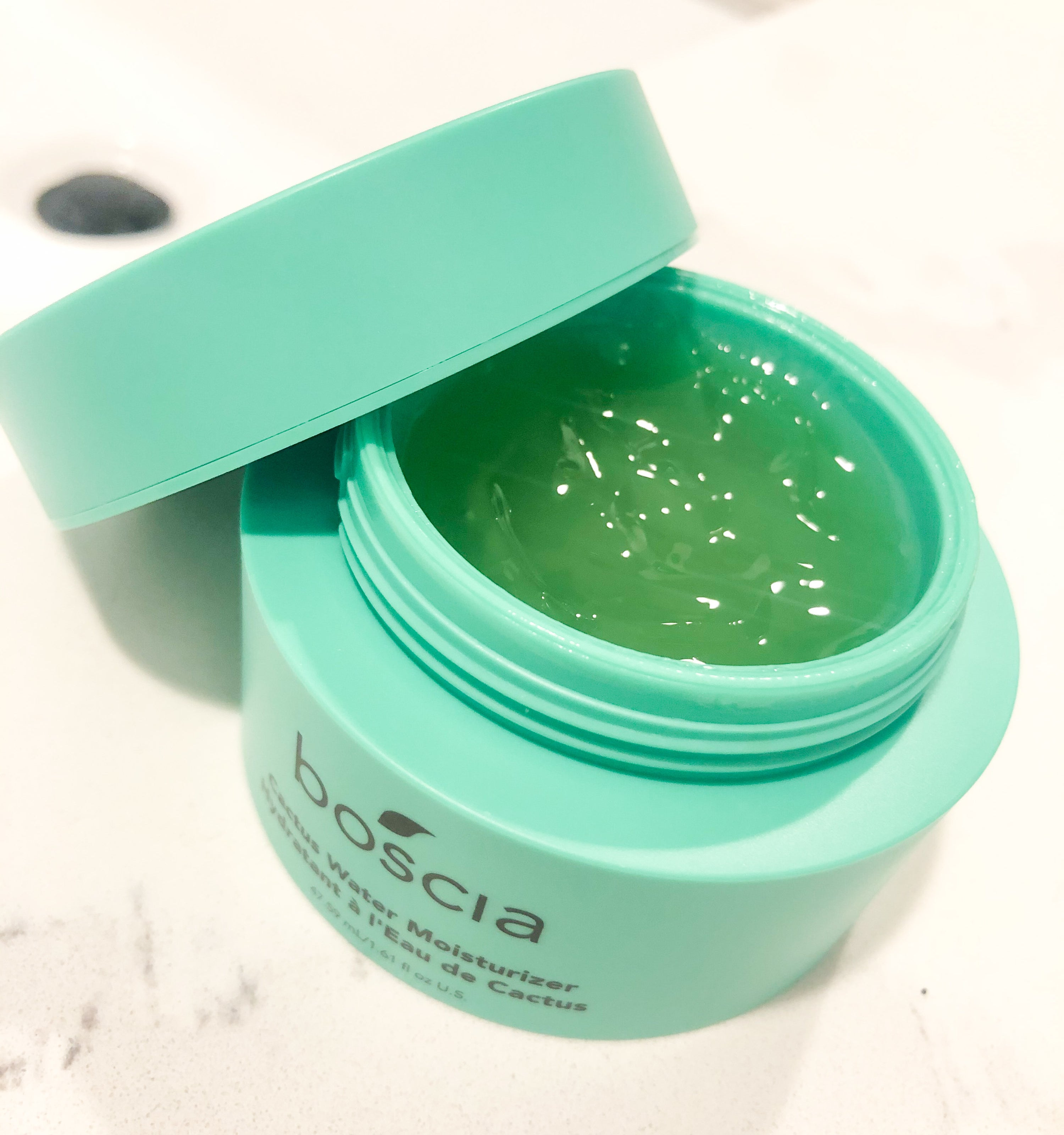 A close up of an open jar of the moisturizer, showing off its gel texture