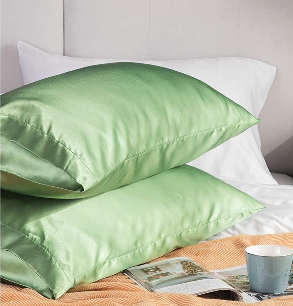 Two pillows with the cases on them
