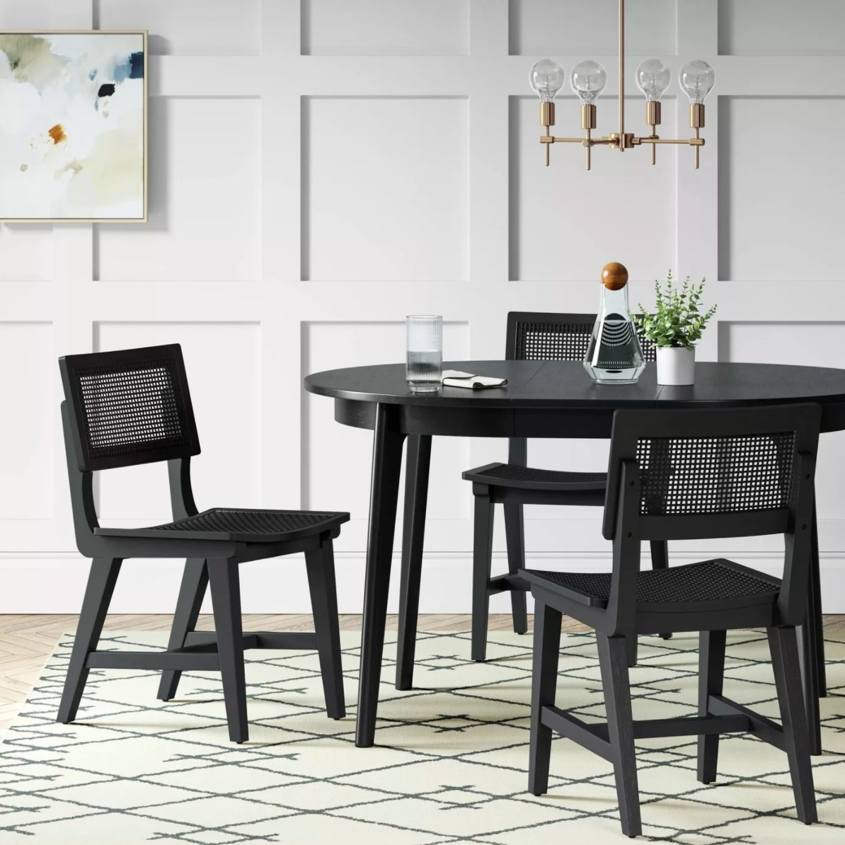 The midcentury round extendable dining table in black