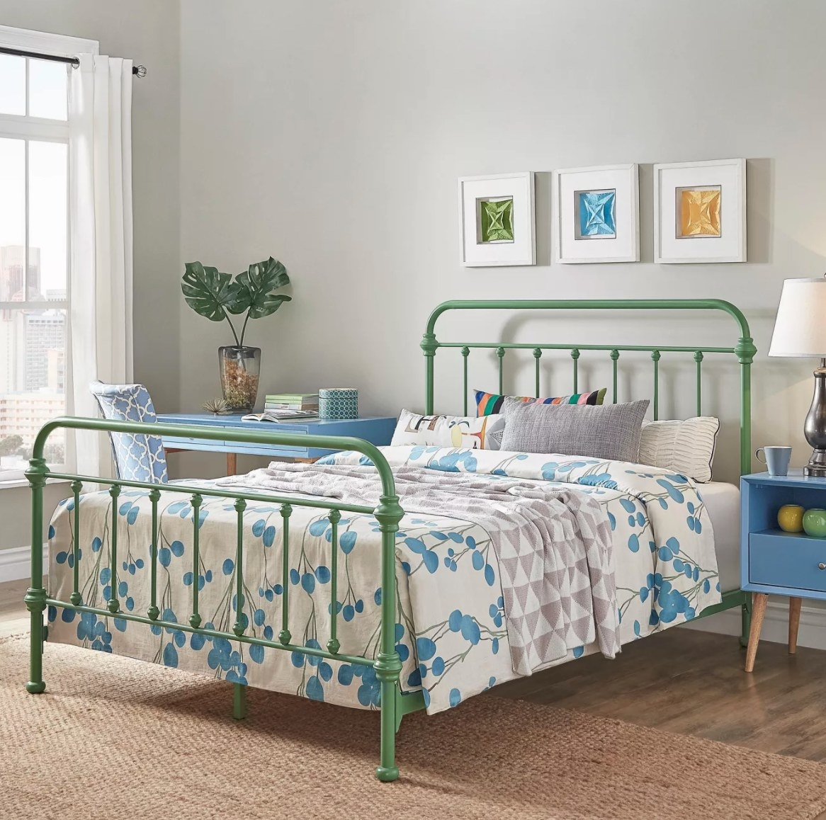 The green metal bed