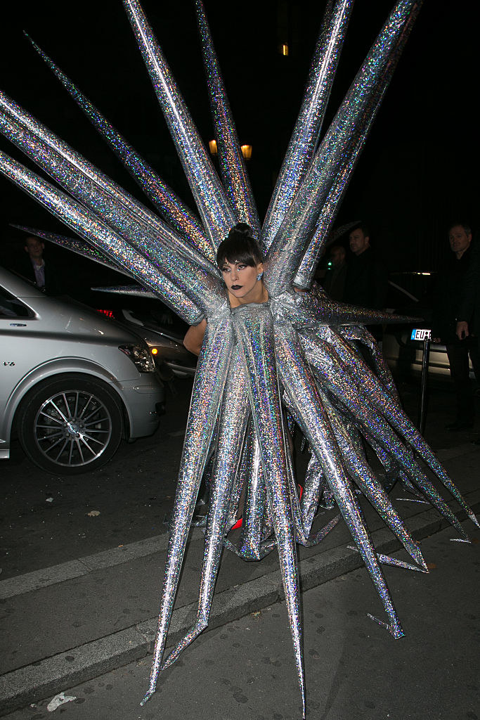 Gaga stepping out of her car in a dress that's all holographic spikes