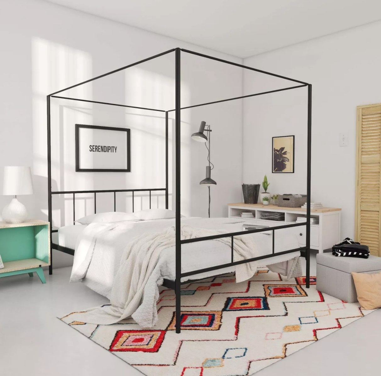 a bed frame with a black metal canopy built around it