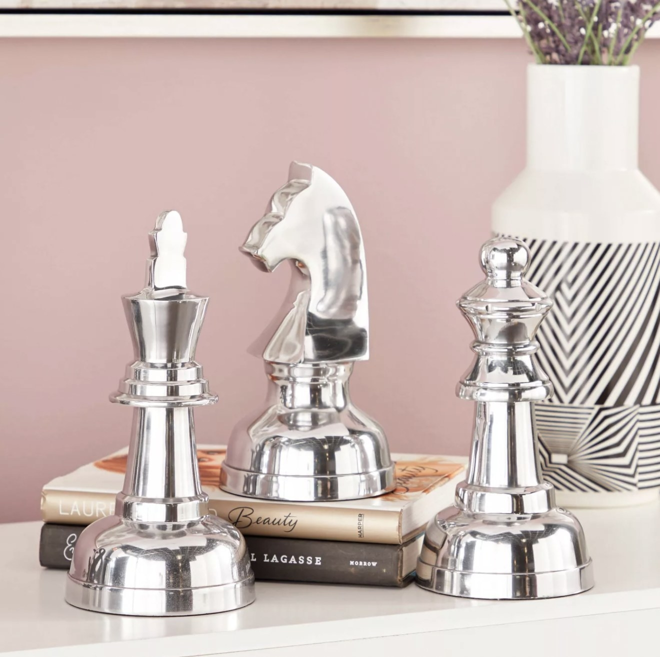 a three-piece chrome sculpture set that look like chess pieces