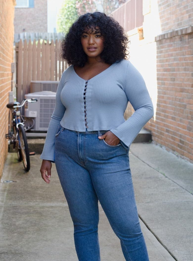 model wearing baby blue cropped top
