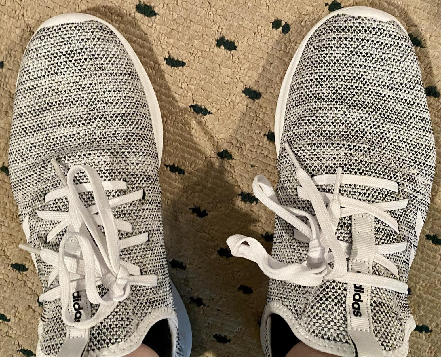 buzzfeed editor's grey and white fabric sneakers
