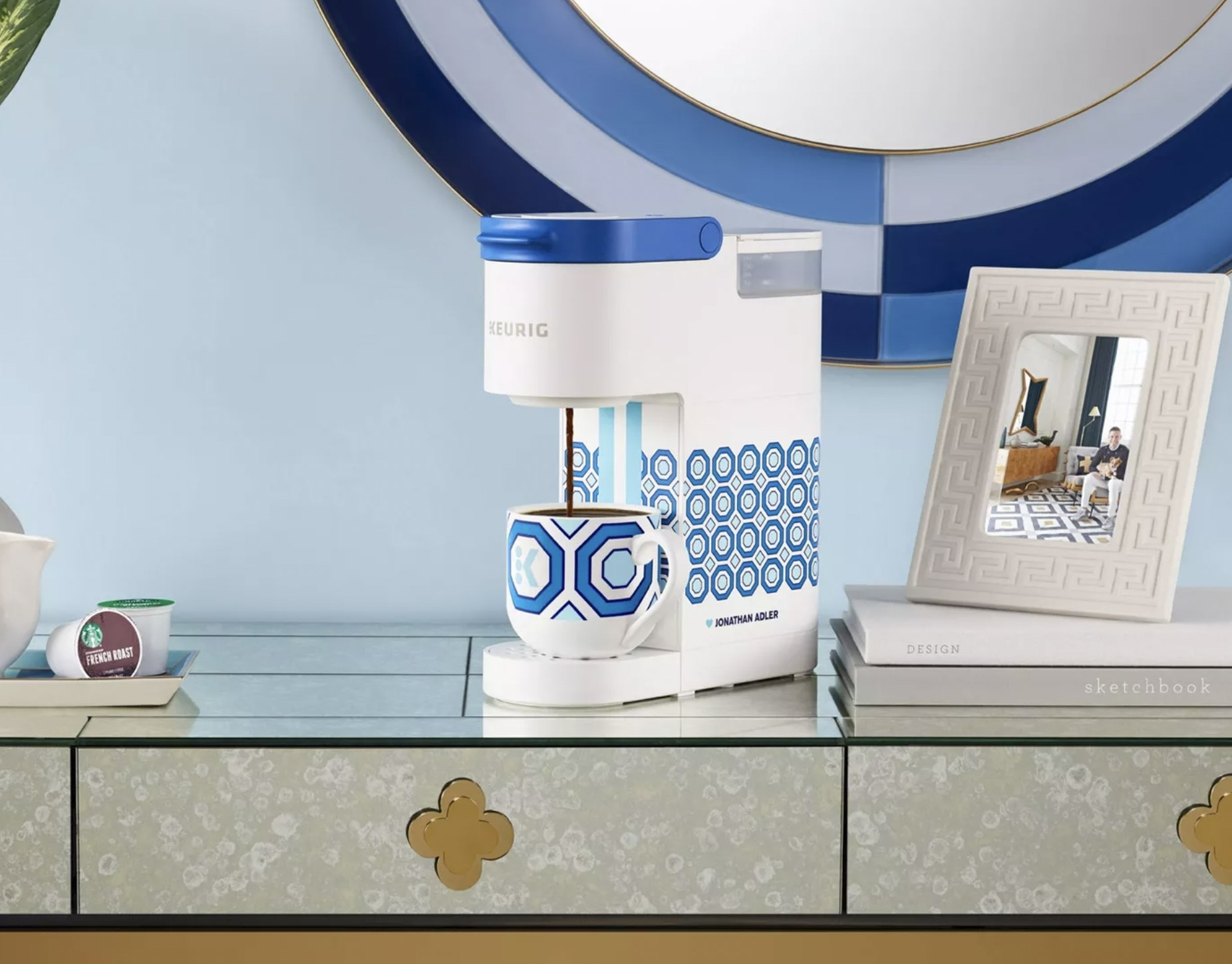 a blue and while Jonathan Adler Keurig machine on a counter