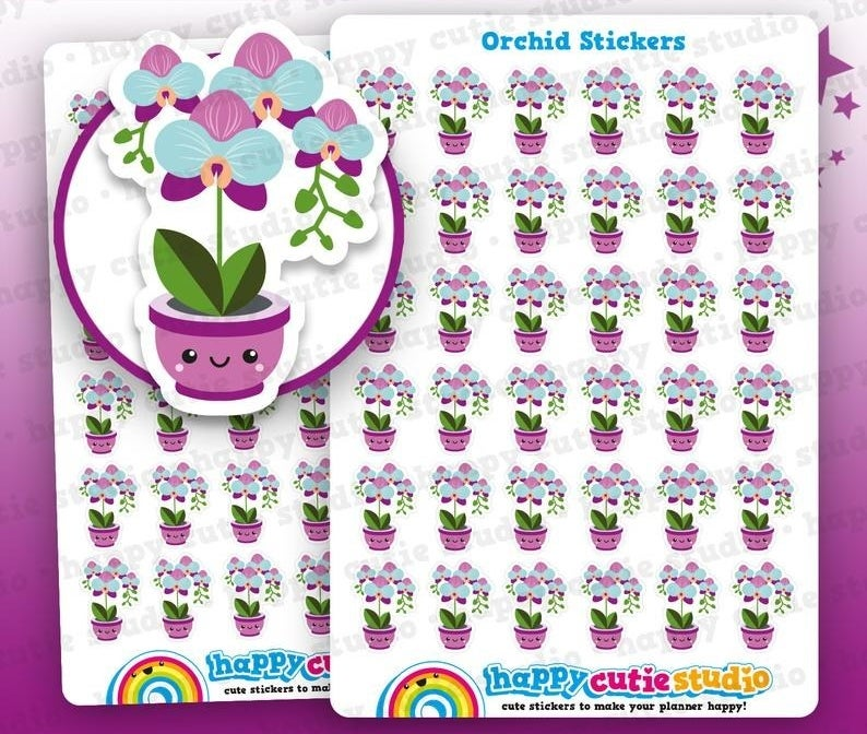 sheets of small stickers shaped like purple orchids with smiley faces