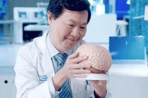 Dr. Ken Jeong looking lovingly at a brain