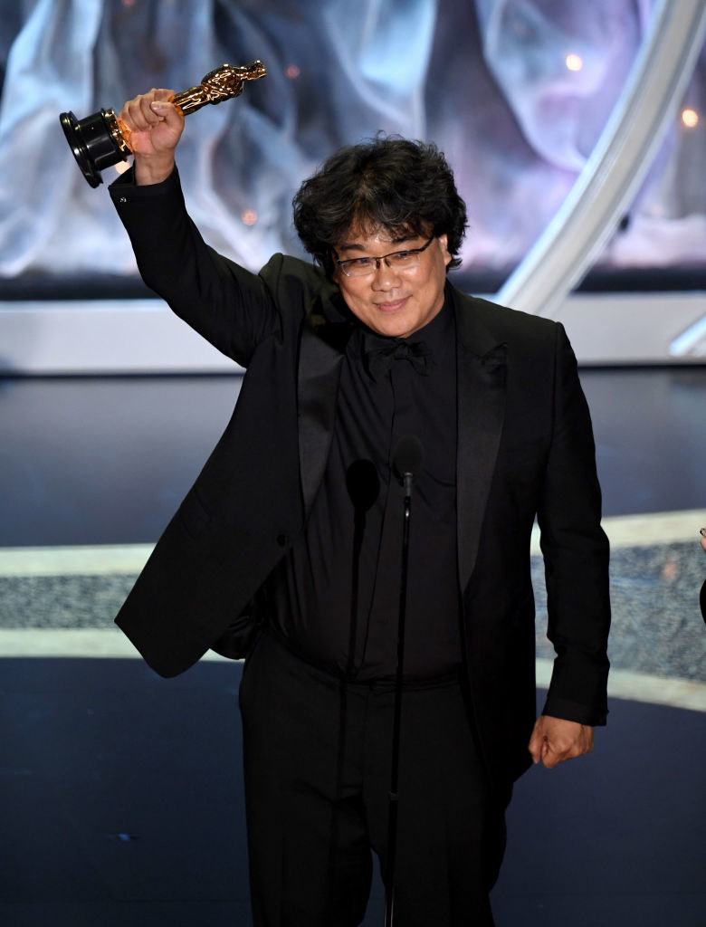 Bong Joon-ho accepts the International Feature Film award for 'Parasite' onstage during the 92nd Annual Academy Awards