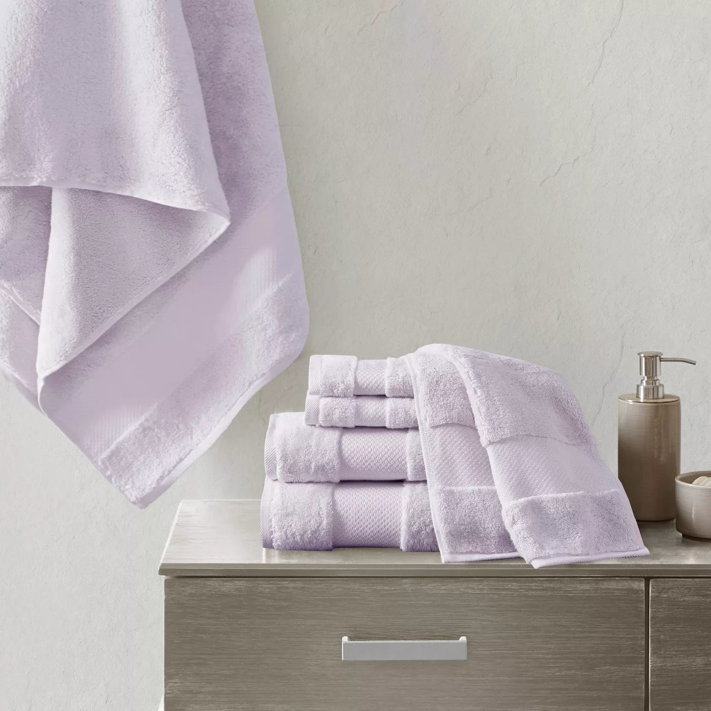 The towel set in lilac in a bathroom