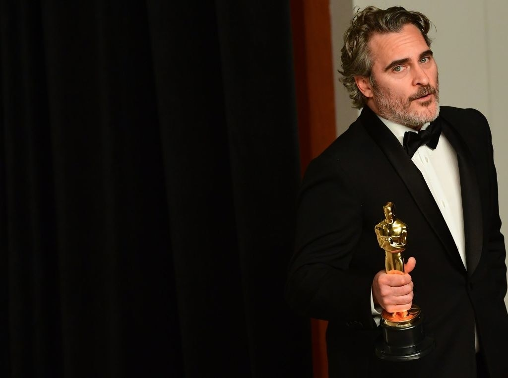 """Joaquin Phoenix poses in the press room with the Oscar for Best Actor for """"Joker"""" during the 92nd Oscars"""