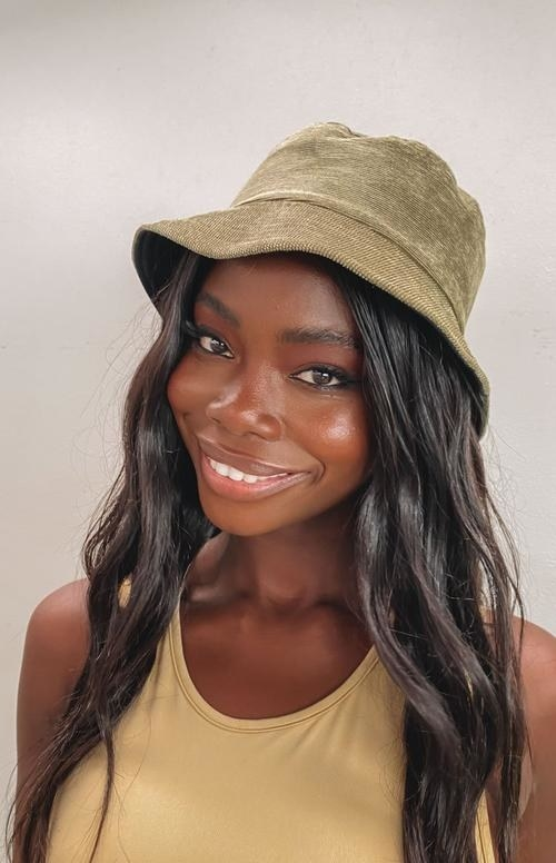 model wearing the green hat