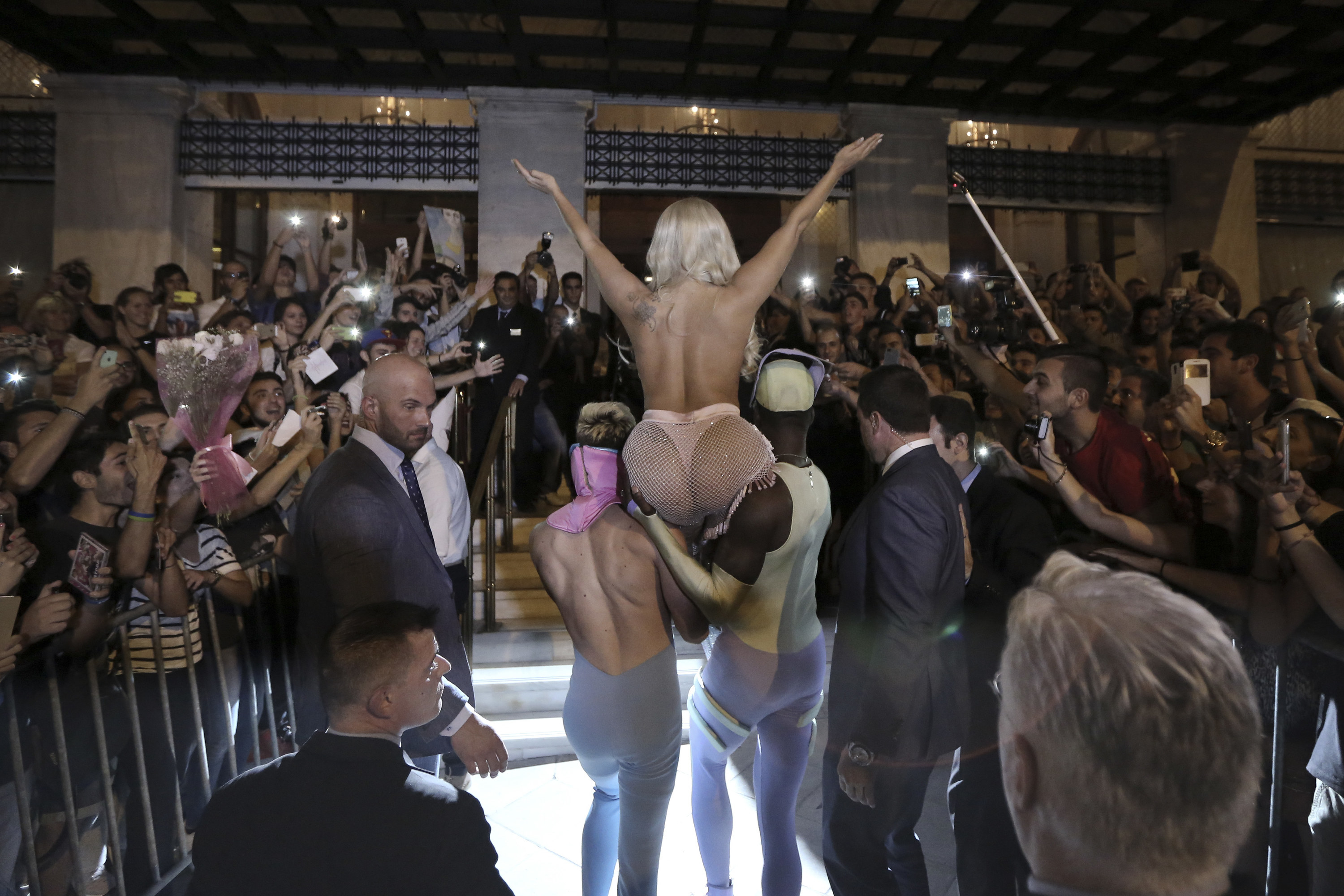 A back view of Gaga doin a V with her arms