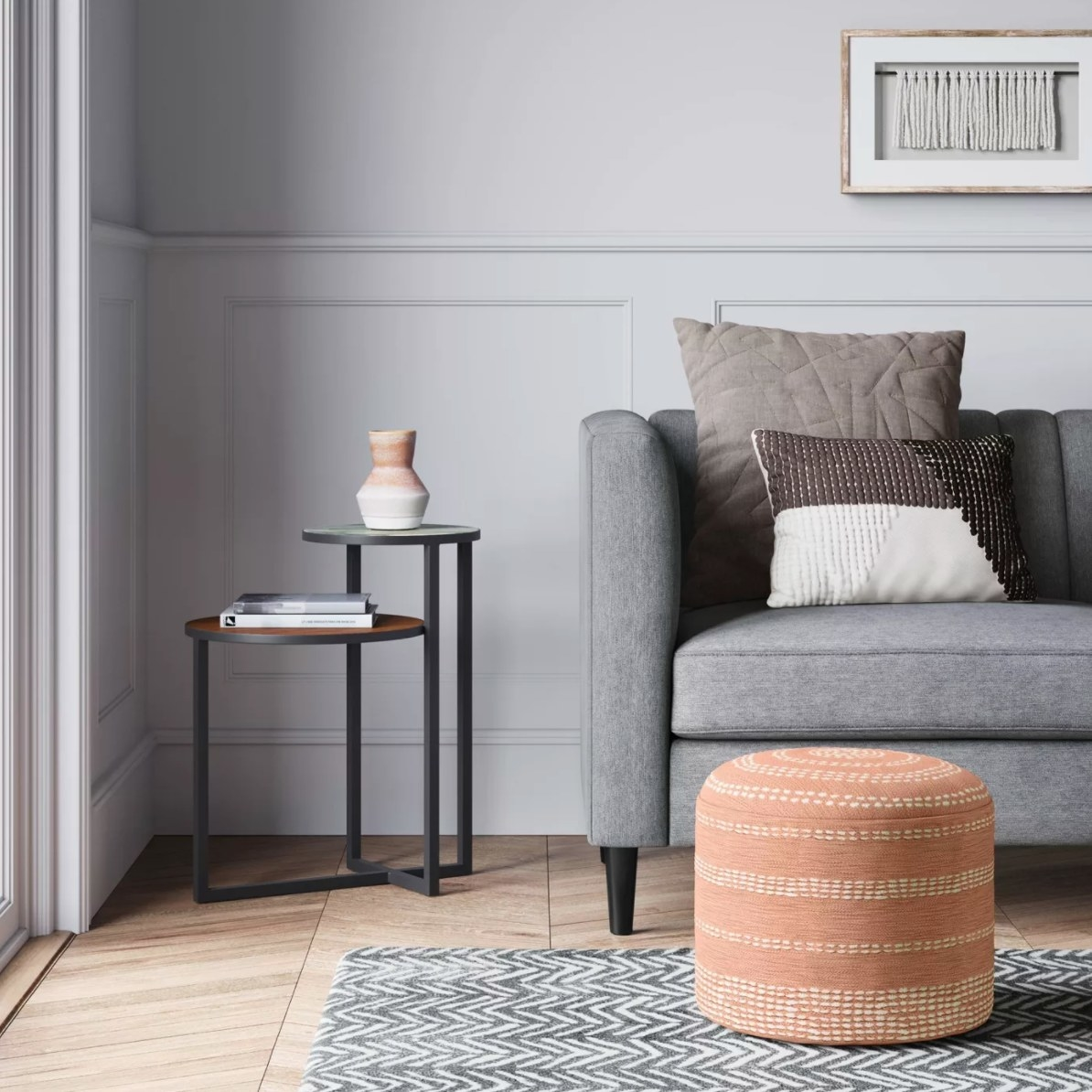 The pouf pillow in coral with white detail