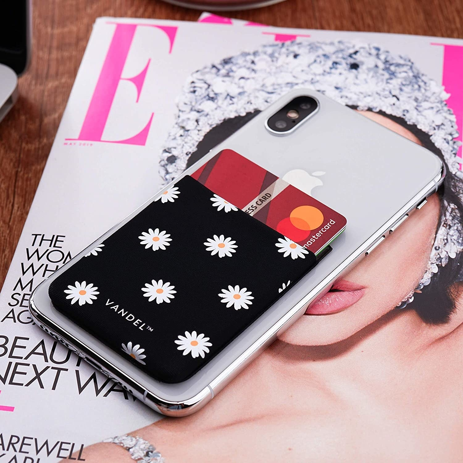 phone with the black and white daisy print pocket on the back
