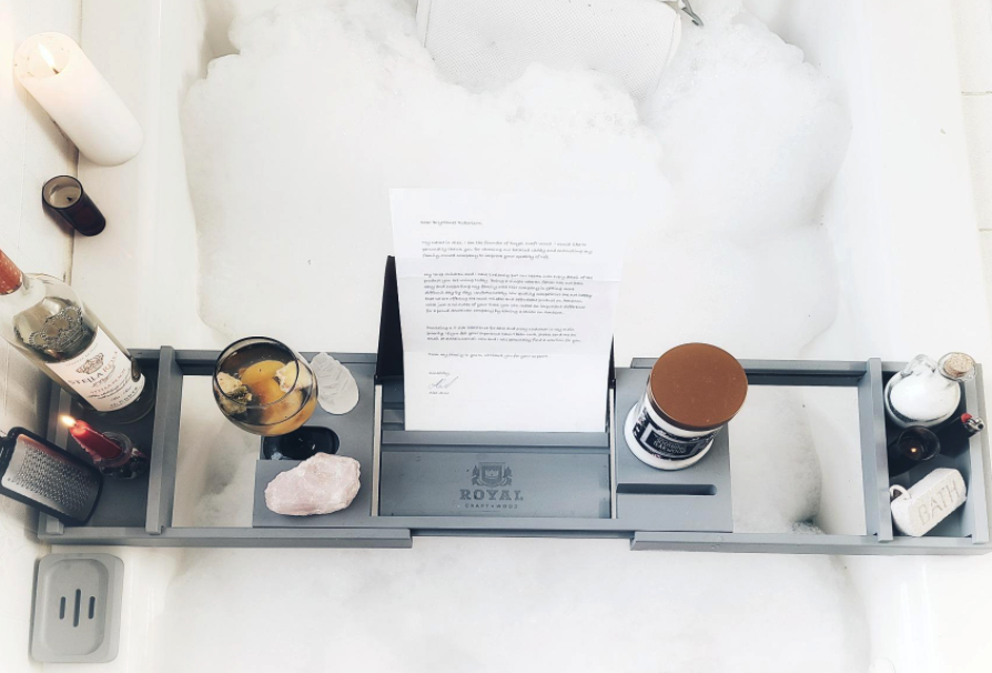 reviewer image of tray in bathtub holding wine, soaps, and candle