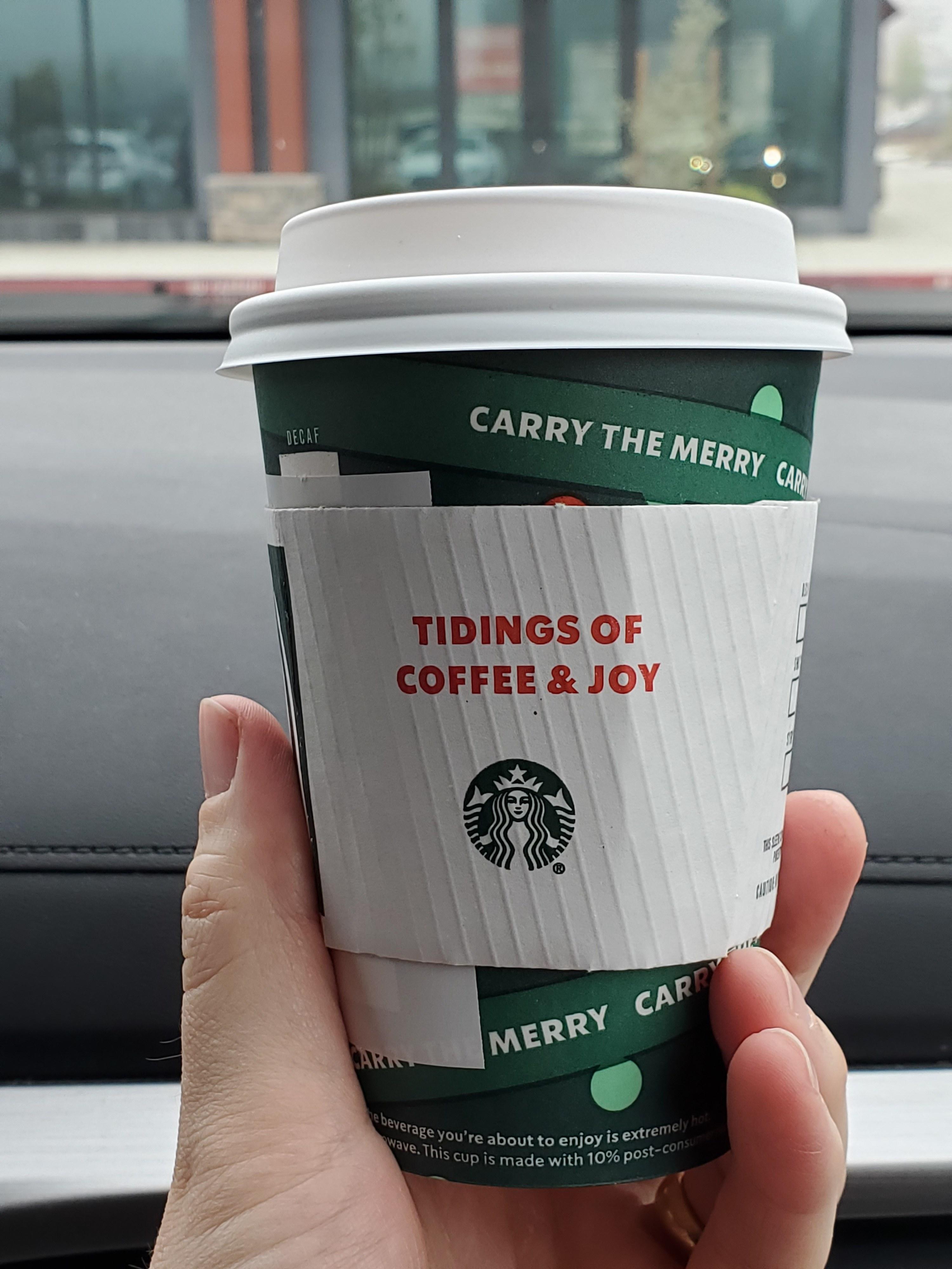A Christmas-themed Starbucks cup