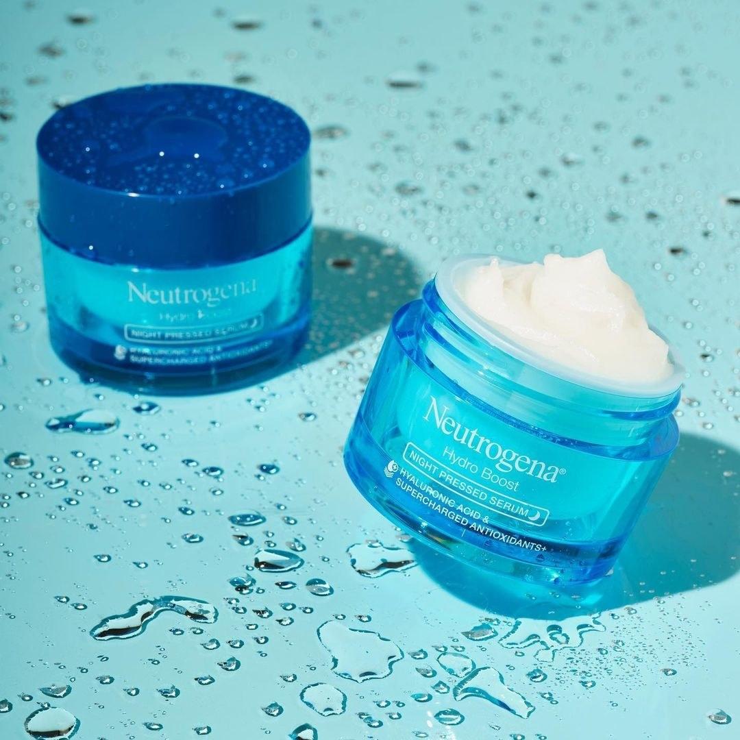 Neutrogena Hydro Boost serum against wet background