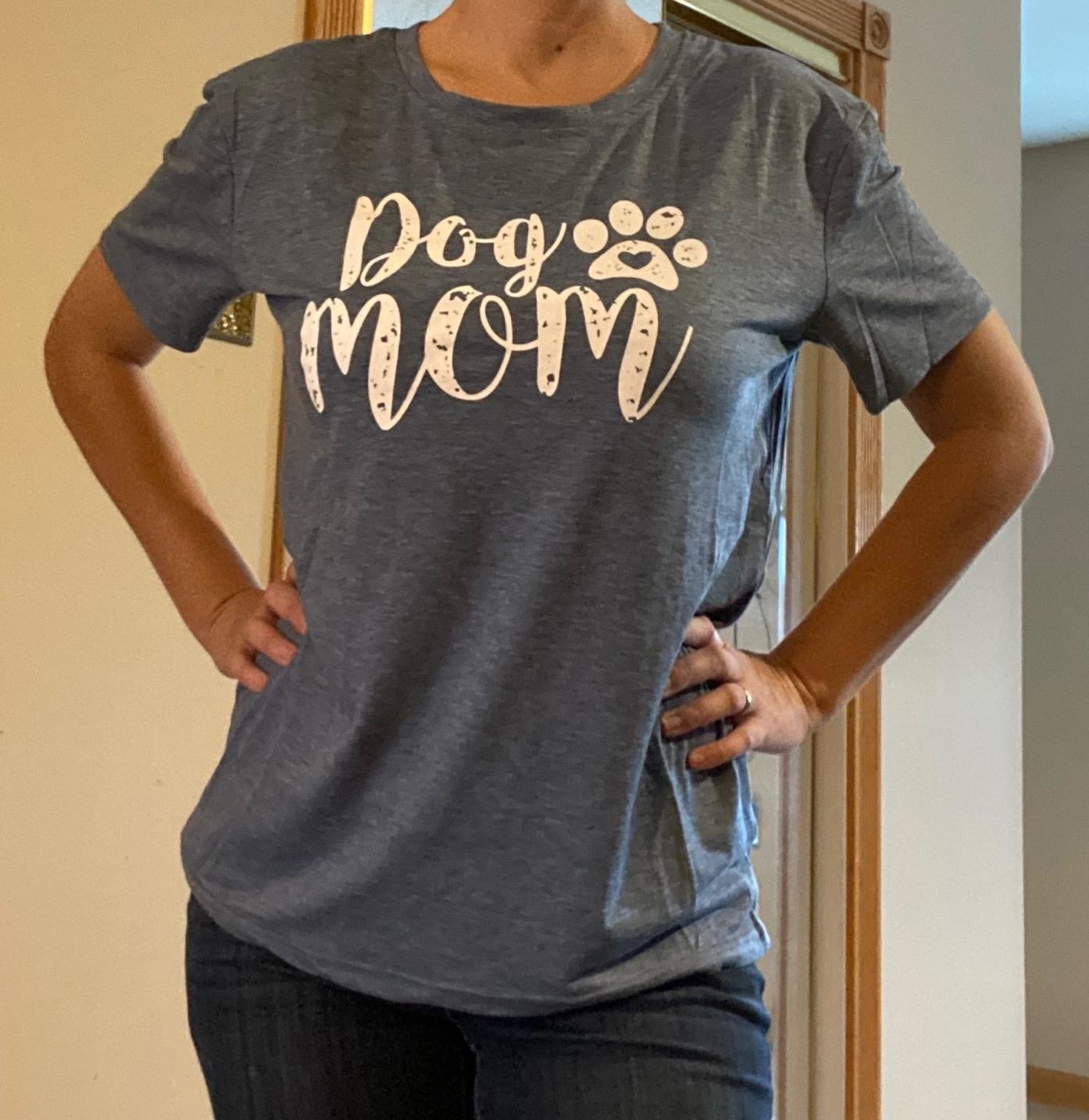 """The shirt, which says """"Dog Mom"""" in white with a paw print design next to it, in gray"""