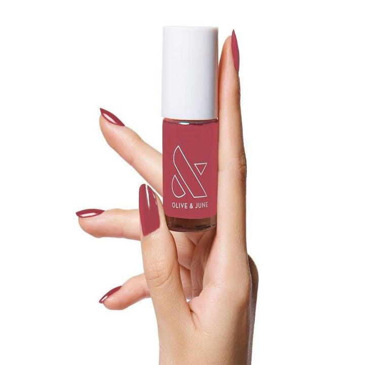 hand holding nail polish