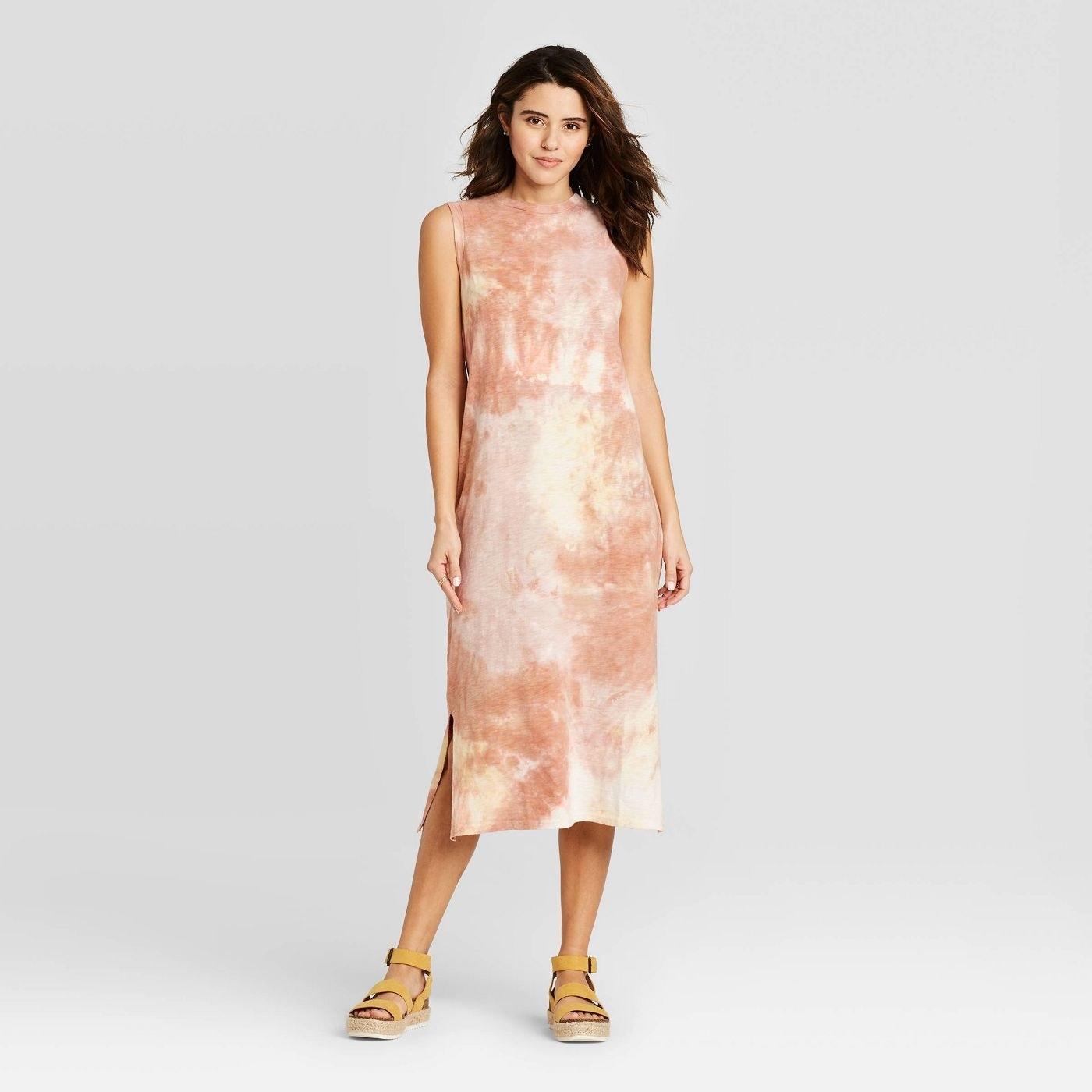 model wearing tie-dye sleeveless dress