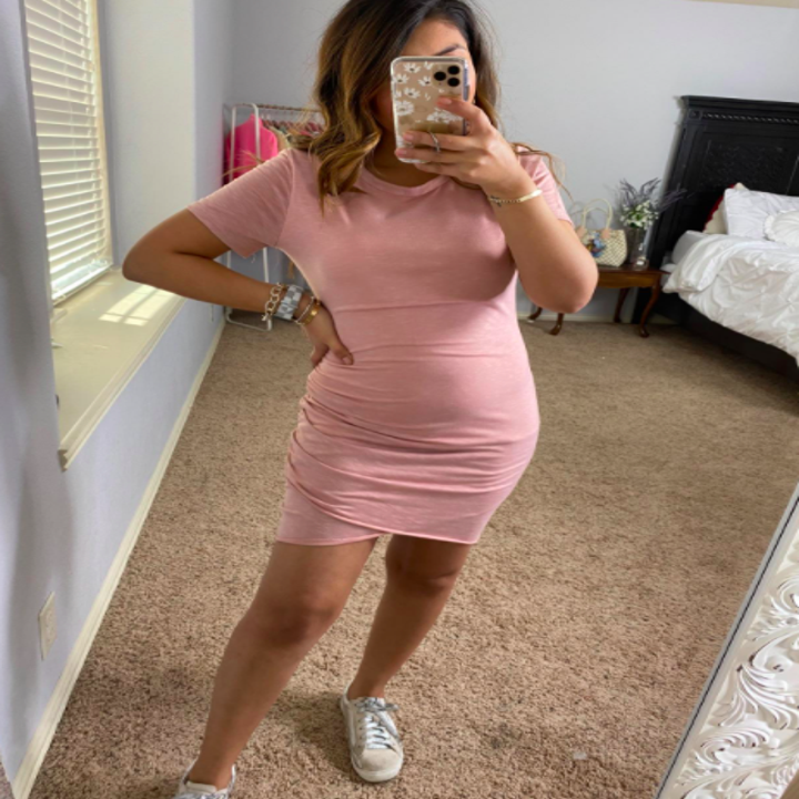 A customer review photo of the T-shirt dress in pink