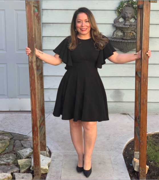 A customer review photo of them wearing the dress in black