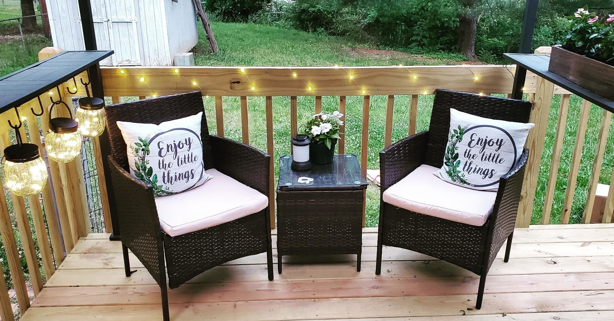 Three-piece dark brown rattan chairs with matching end table