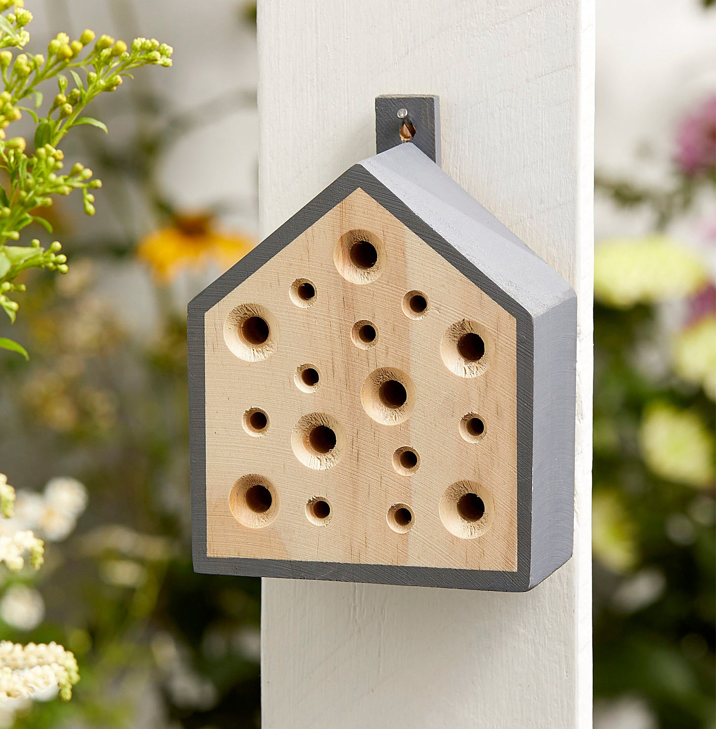 The bee house on an outdoor pillar