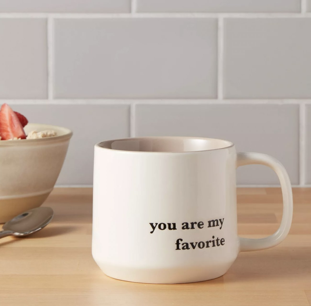 "a mug that reads ""you are my favorite"" resting on a counter"