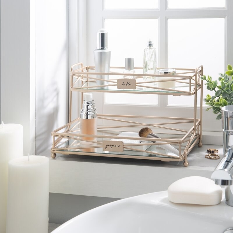 the mirrored vanity tower holding various toiletries