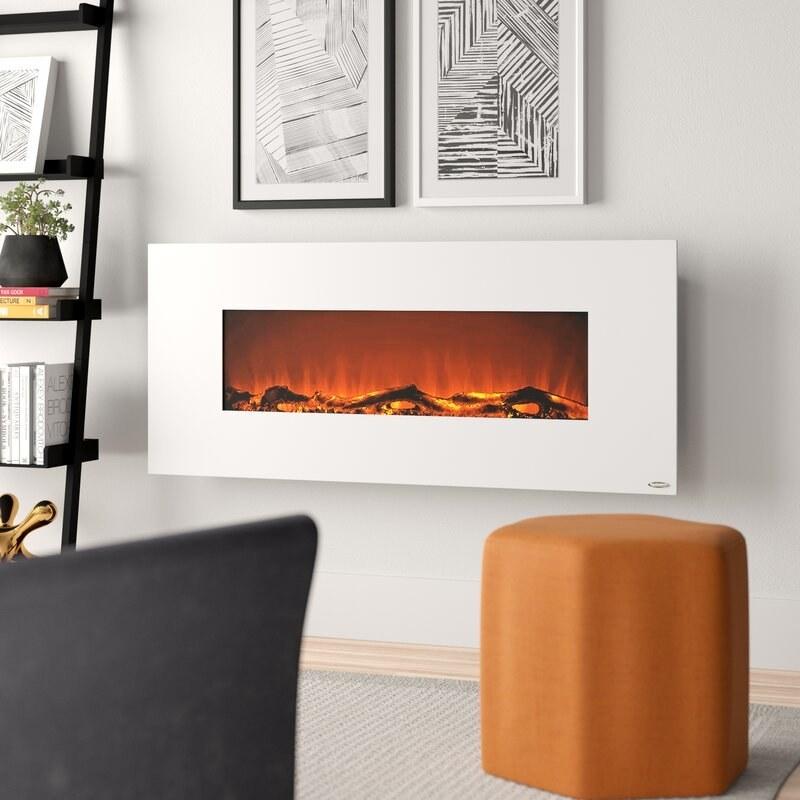 a white wall-mounted fireplace