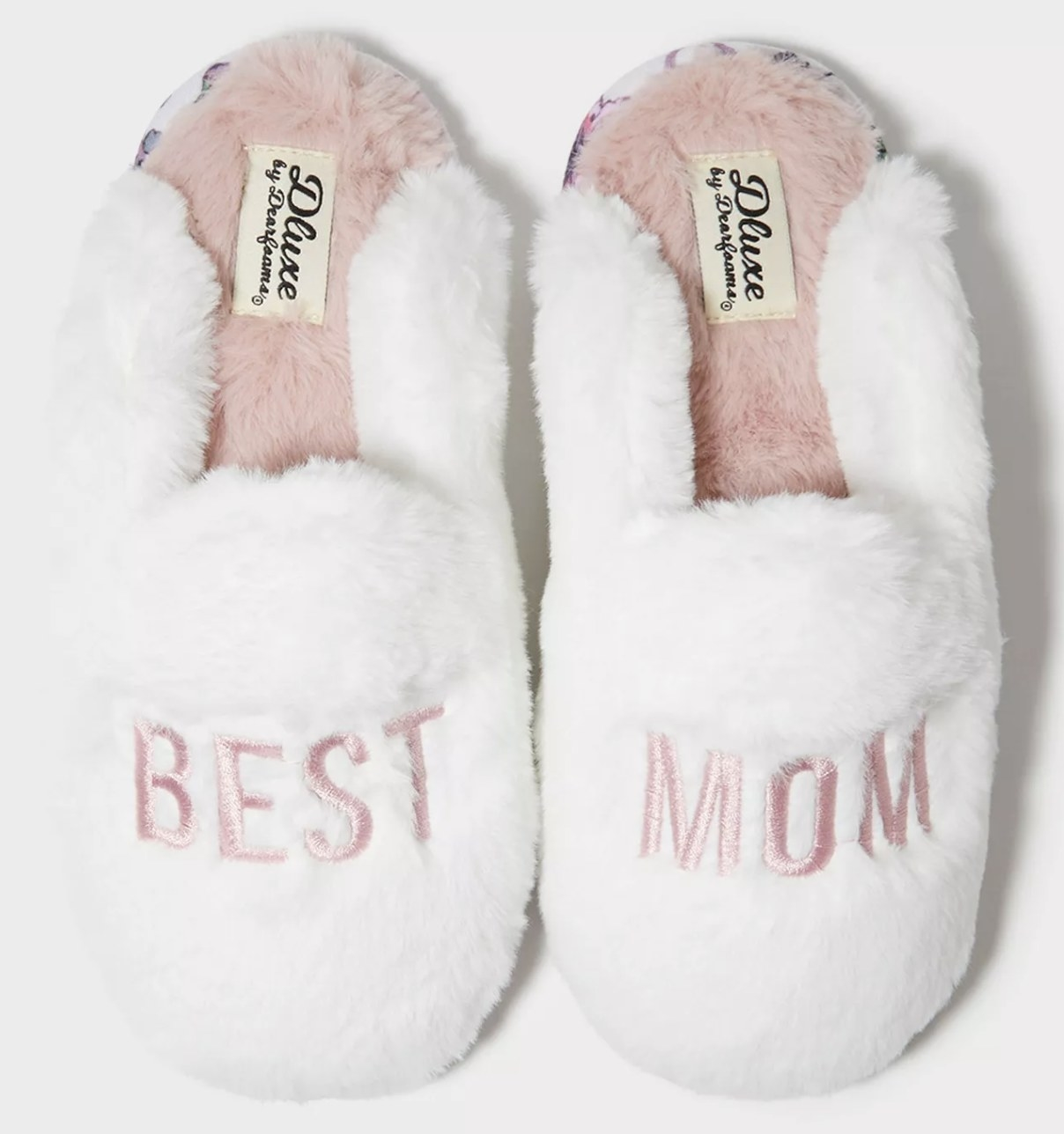 "white fuzzy slippers that reads ""best mom"" in pink writing"