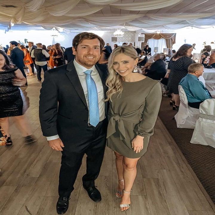 reviewer wearing the green prettygarden tie waist dress with heels at a wedding