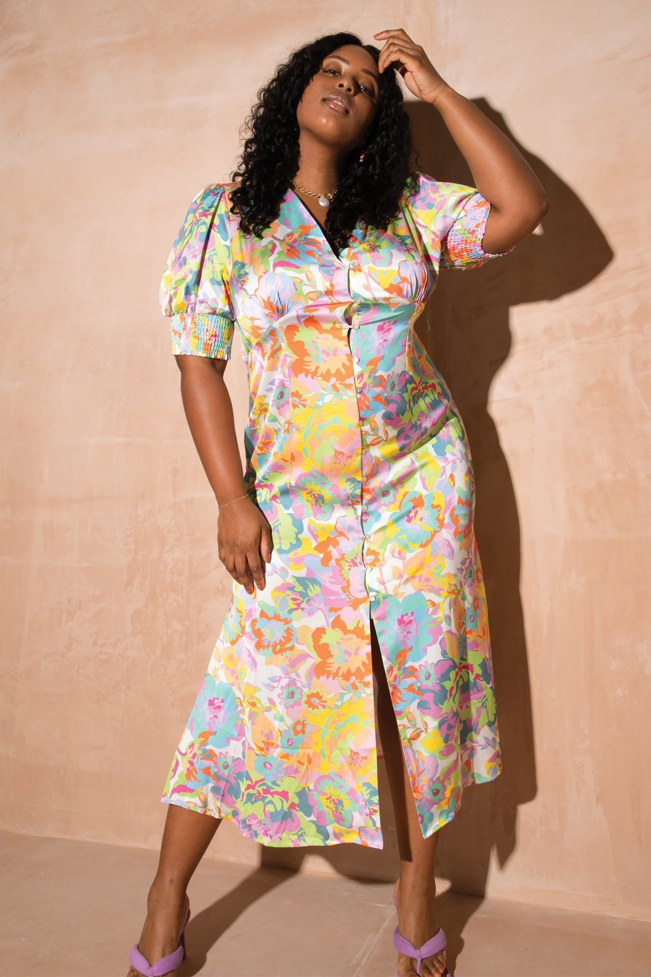 model wearing the multi-colored cap sleeve dress