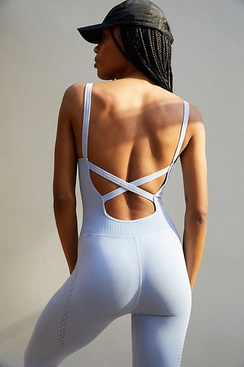 back view of a different model wearing the criss-crossed jumpsuit in periwinkle