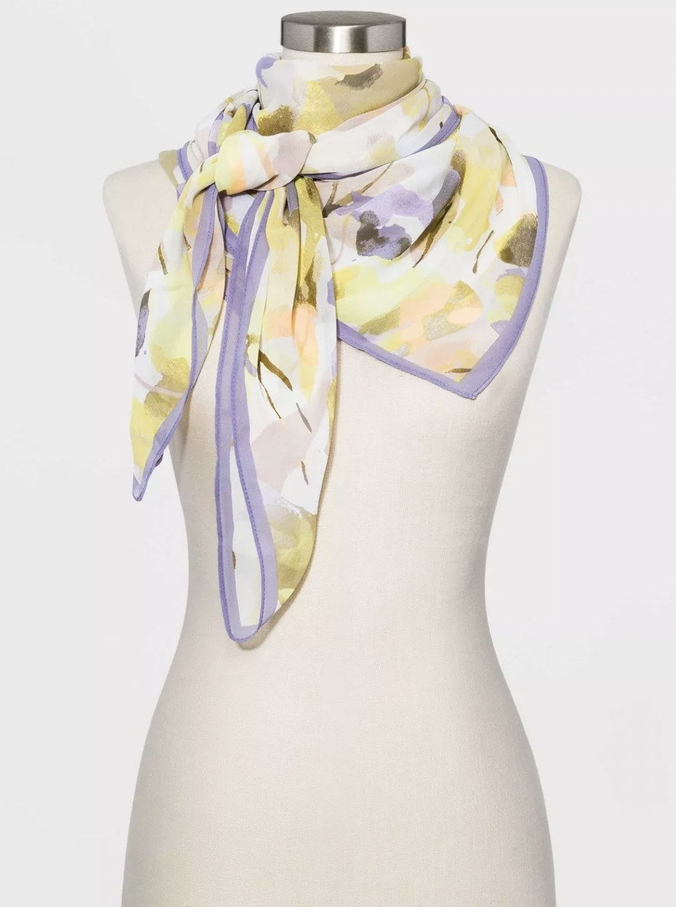 a printed square scarf on a mannequin