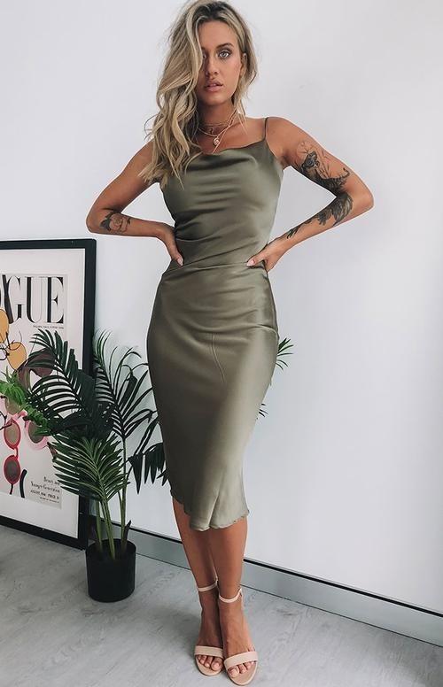 model wearing the midi green dress