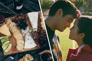 "A wooden board covered in fruits, cheese, crackers, and jam and Lana Condor as Lara Jean and Noah Centineo as Peter in the movie ""To All the Boys I've Loved Before."""