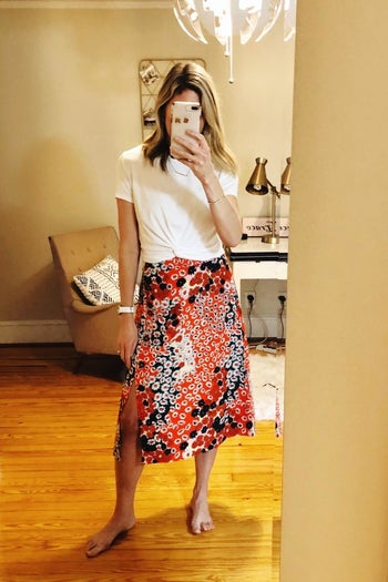 a reviewer wearing the skirt in red