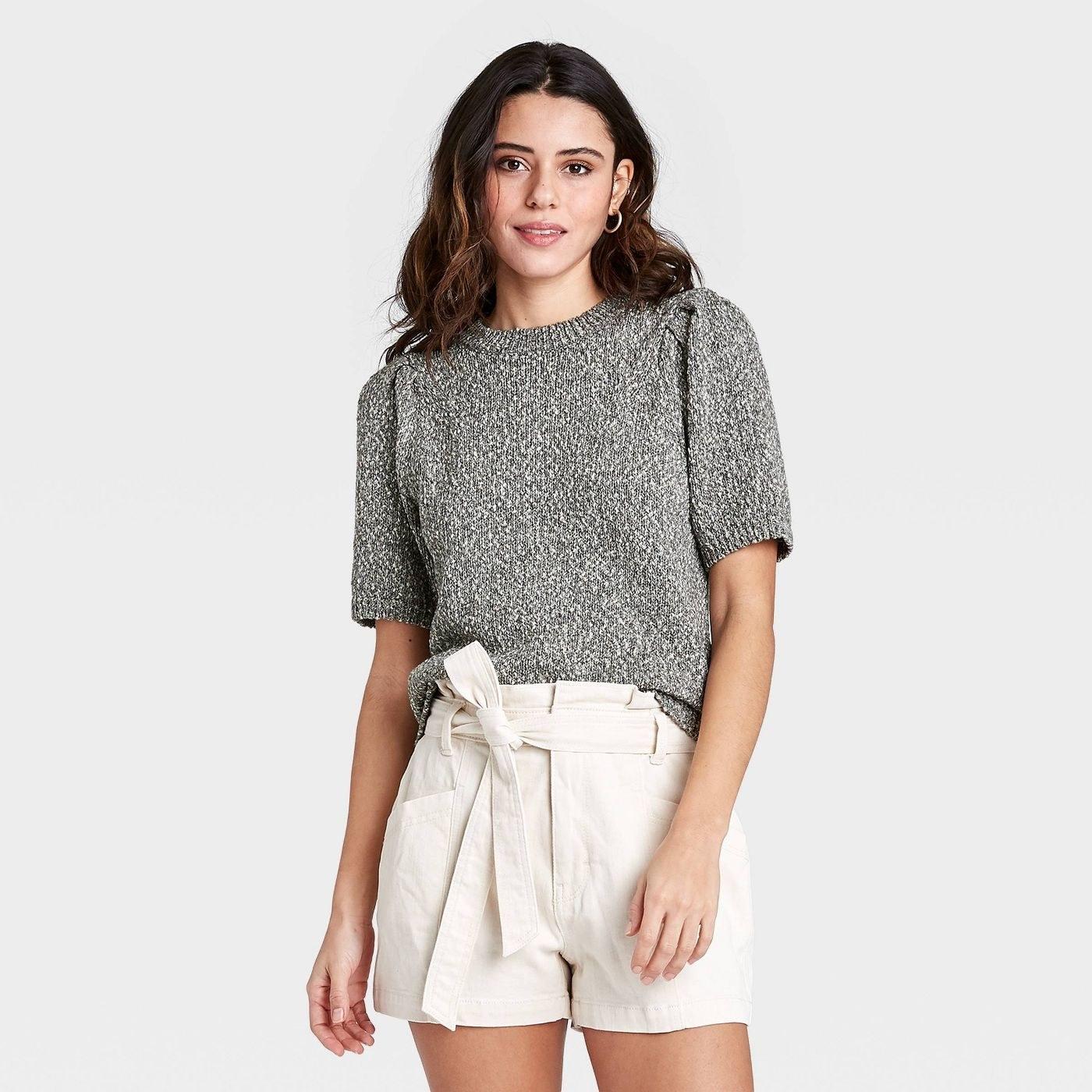 Model wearing short sleeve gray sweater