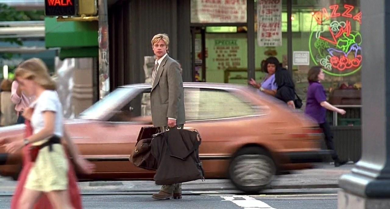 Brad Pitt standing near a car in Meet Joe Black