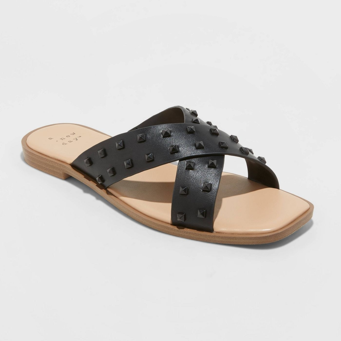Sandals with black cross over leather with studs and tan sole