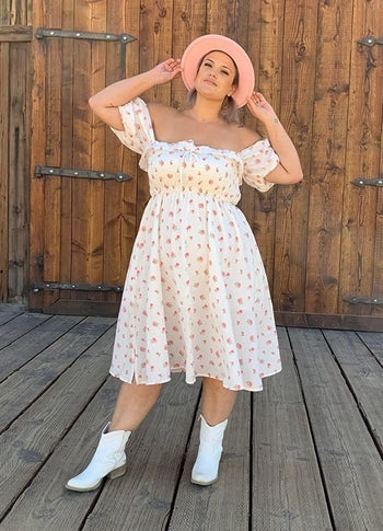 a different reviewer wearing the dress in white and pink