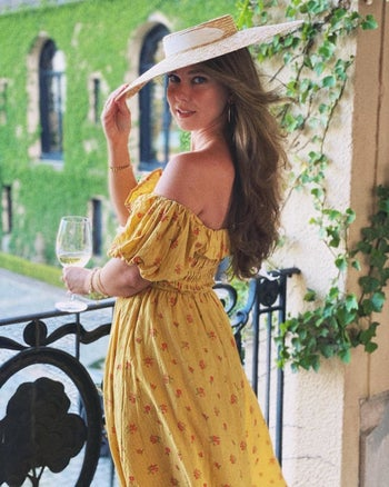 a reviewer wearing the dress in yellow