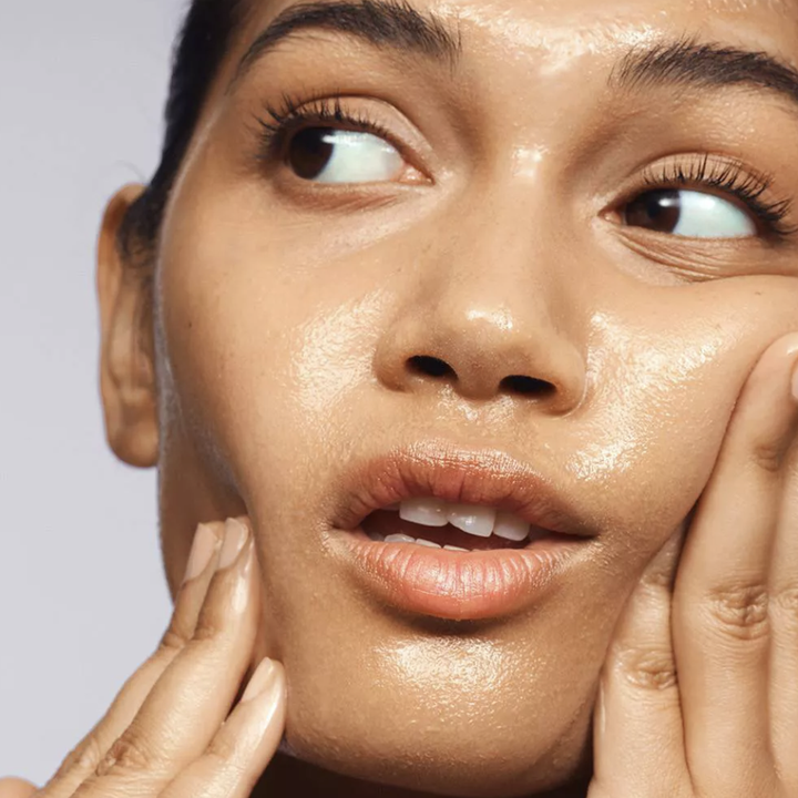 a model using the cleansing balm