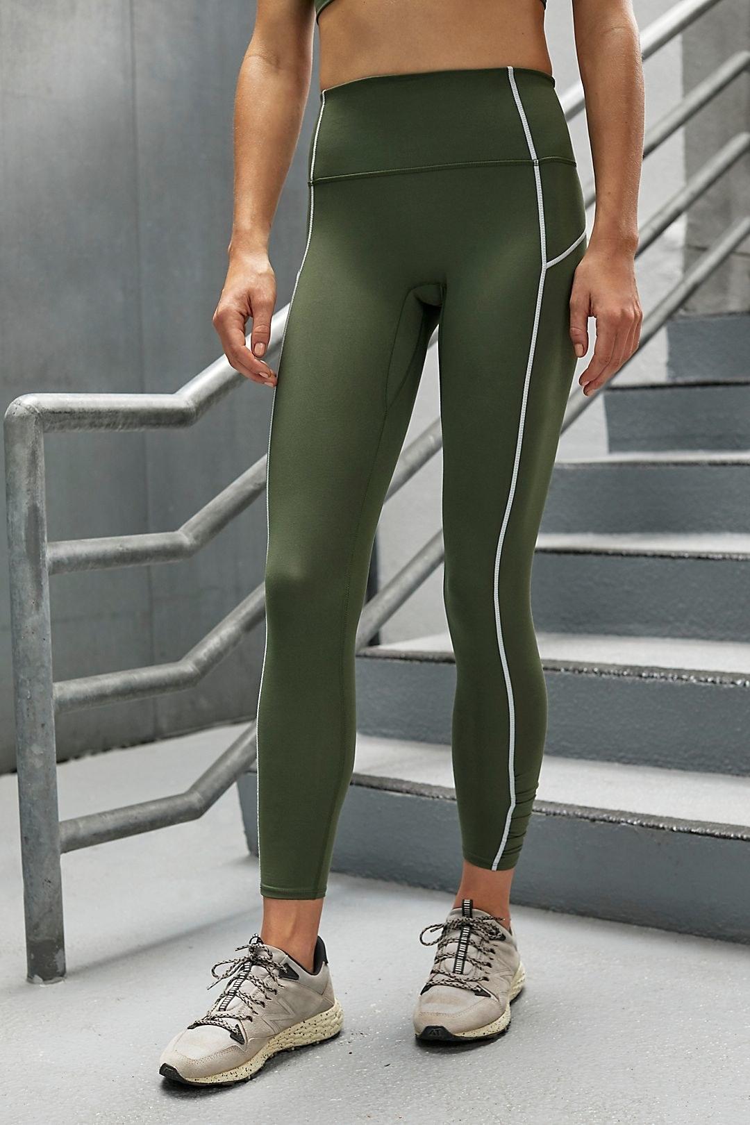 model wearing green leggings