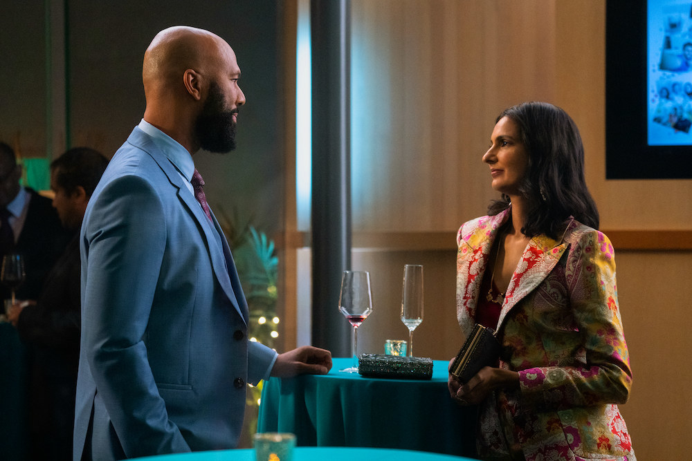 Dr. Jackson and Nalini looking at one another at an event