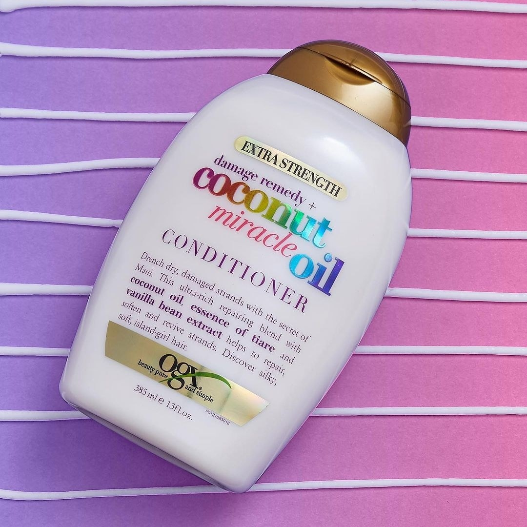 A flatlay of the conditioner on a colourful background