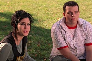 """Janis and Damian from """"Mean Girls"""" sitting outside on the grass"""